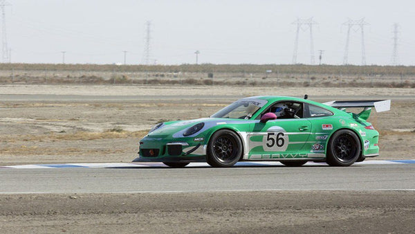 Oloi's 2014 Porsche 911 GT3 on the track at Buttonwillow Raceway