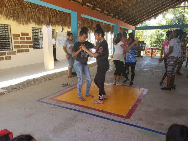 A World Without Walls student practices her dancing in the Dominican Republic