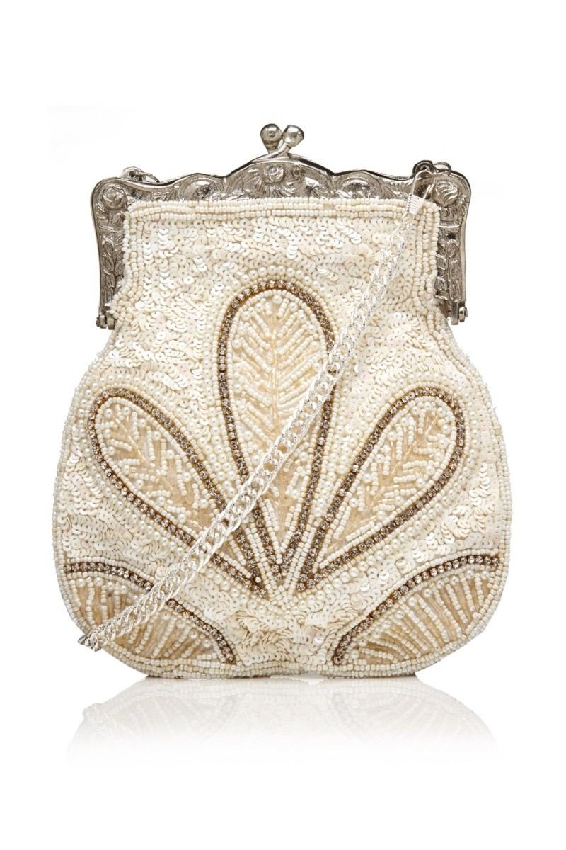 1920s Accessories: Feather Boas, Cigarette Holders, Flasks 1920s Vintage Hand Beaded Purse in Cream $148.00 AT vintagedancer.com