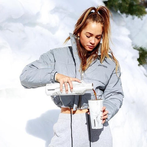 Corkcicle-Tumbler-with-Girl-in-snow-pouring-coffee