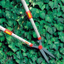 Load image into Gallery viewer, WOLF GARTEN | Telescopic Hedge Shears on the hedge