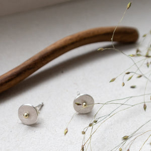 circle dot ear studs with 14k gold dot mezereem jewelry