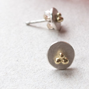 circle dot ear studs with 14k gold triple dots mezereem jewelry