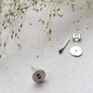 circle dot ear stud with black dot mezereem jewelry