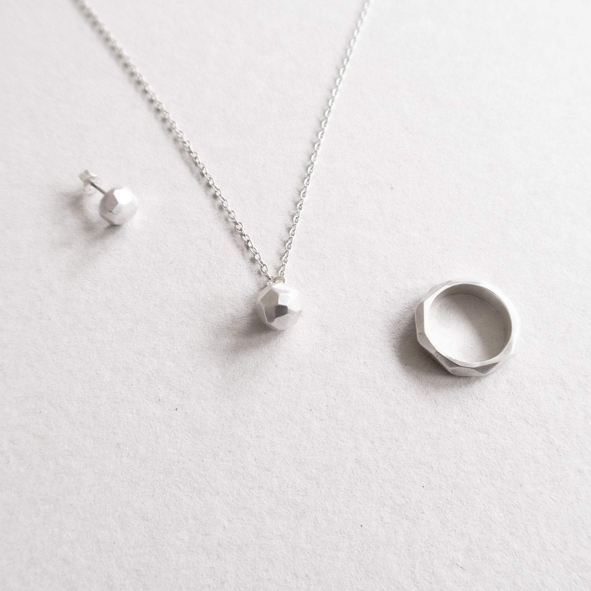 facet series ring, ear stud and pendant
