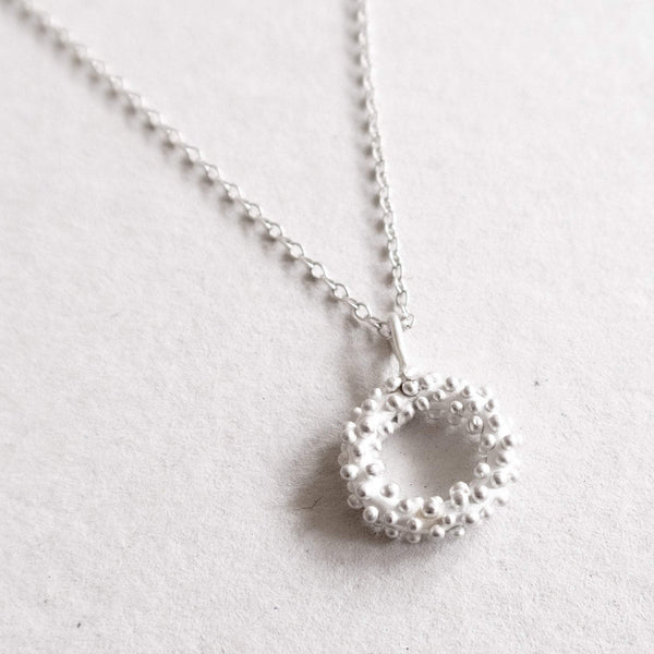 dots circle pendant in silver
