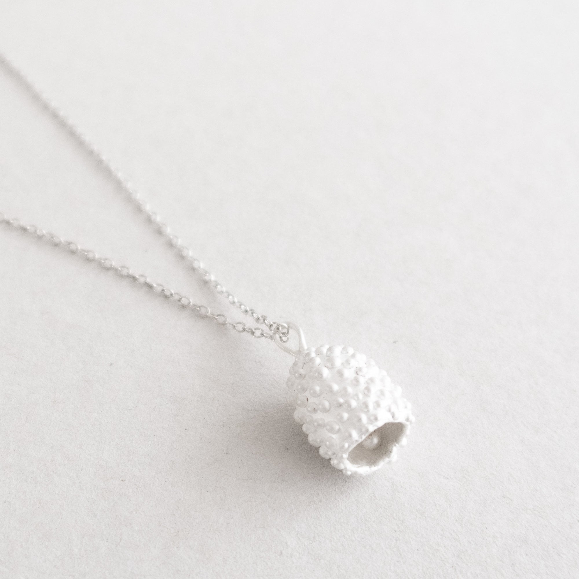 silver dotted bell on chain necklace