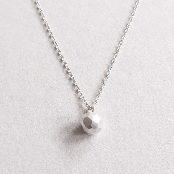 silver facetted ball on necklace