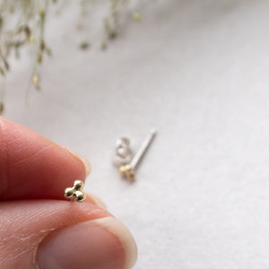golden 14k triple ball ear studs mezereem jewelry in hand
