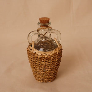 Antique wine jug / Glass jar with wicker woven cover