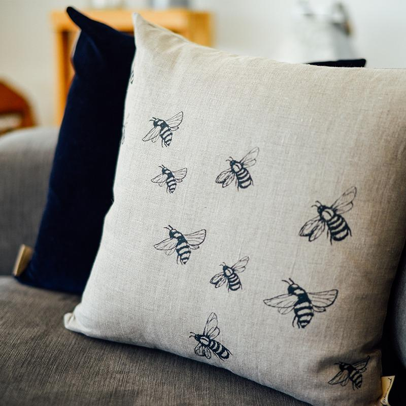 Natural linen bee cushion with navy velvet