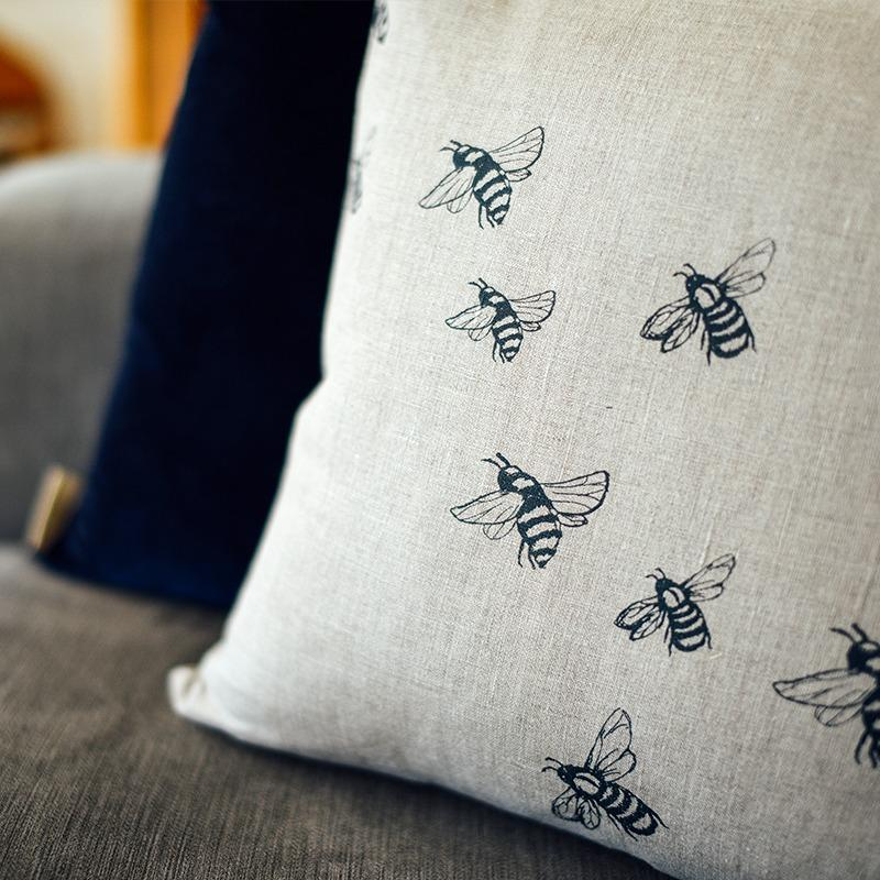 Bee cushion in natural linen