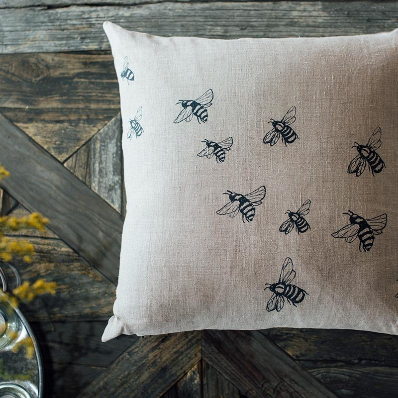 Bee cushion in natural linen with printed bee design