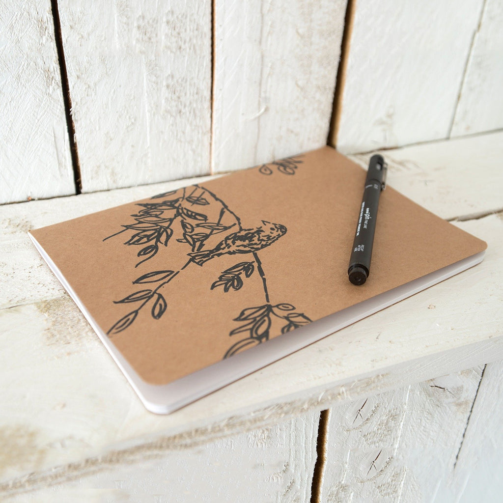 large a5 kraft notebook from the bird song collection plain and lined white paper