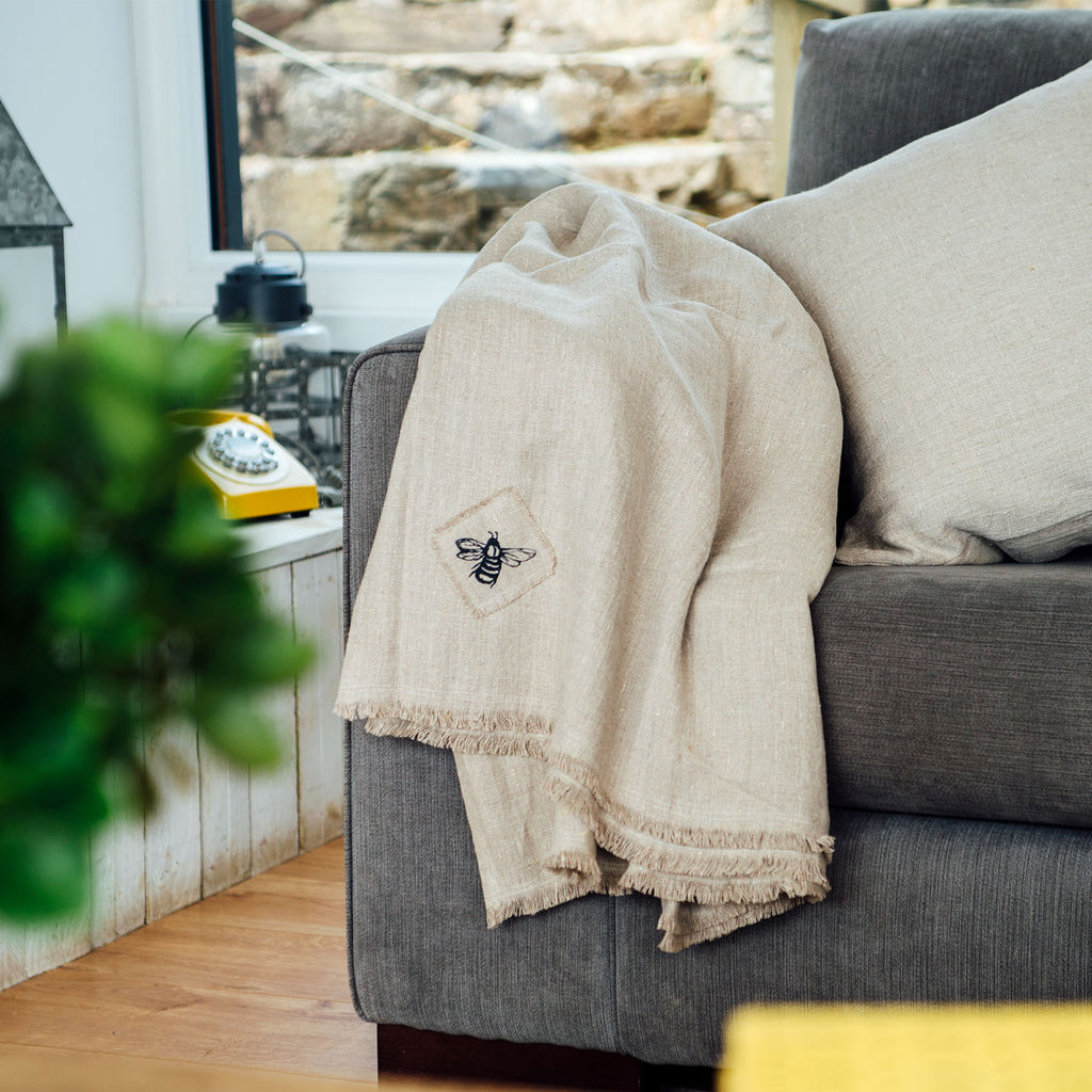 honey bee linen throw in natural linen on the sofa
