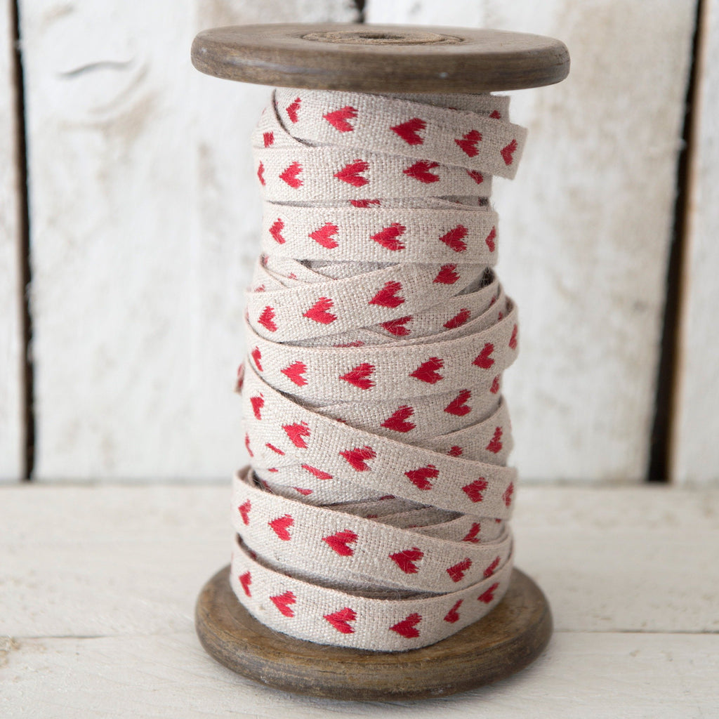 helen round haberdashery linen ribbon with red hearts on natural linen