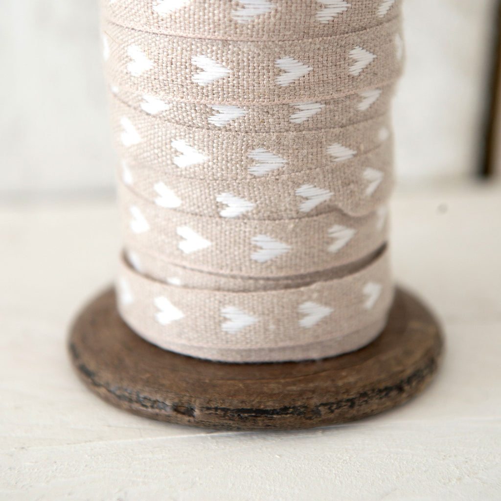 helen round haberdashery linen ribbon with white hearts on natural linen