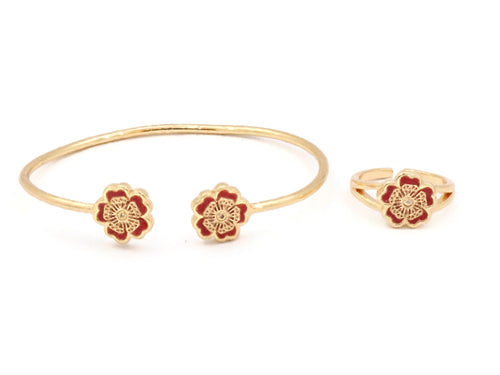 Sterling cuff bangle with red ceramic stones with dual flower design with a similar designed ring