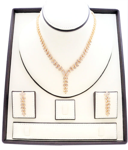 Necklaces for women, Zircon studded Jewelry set with Gold leaf designs embedded with zircon stones.