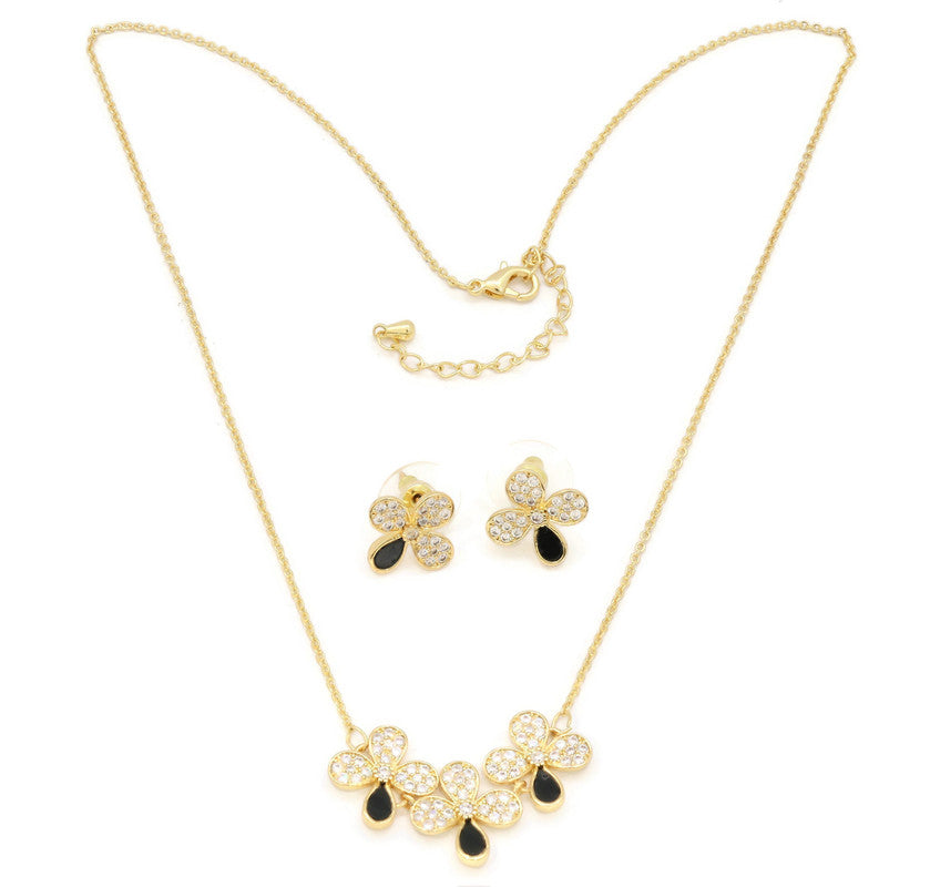 The Zircon Studded Elegant flower with black ceramic studds on the mount, Gold Chain pendant with adjustable chain and lobster clasps
