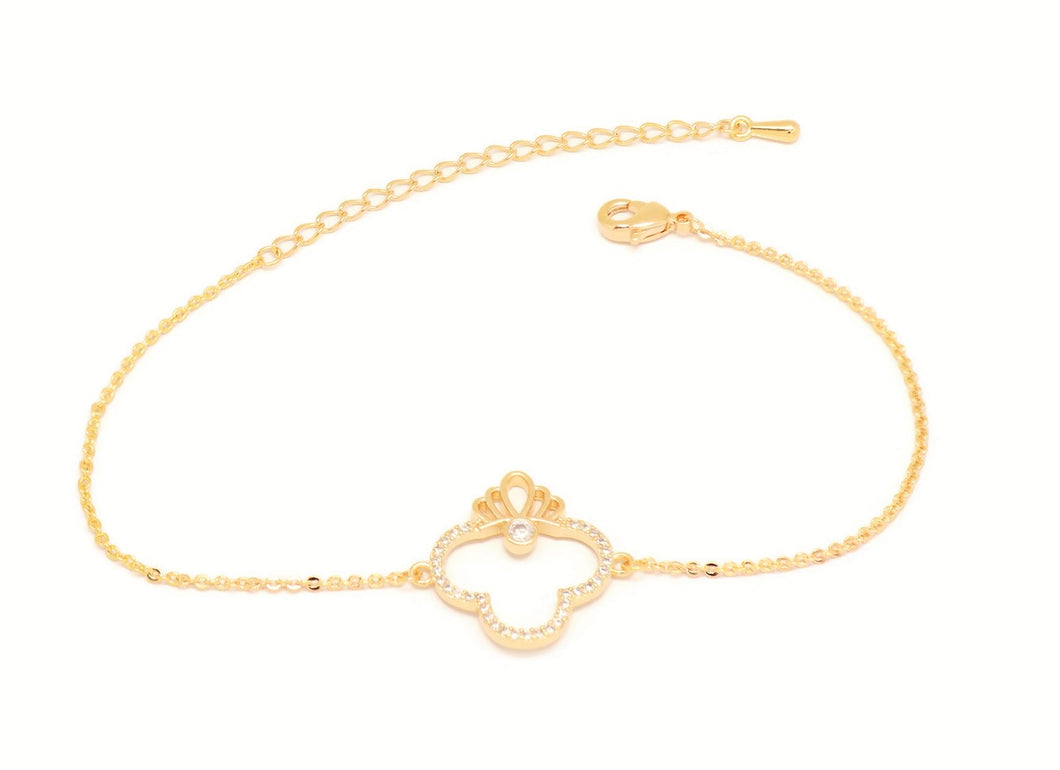 Slider bracelet for women and girls, Charm with a sleek crown design, Emebeded with series of white cubic stones, Gold plated, Lobster claw clasp