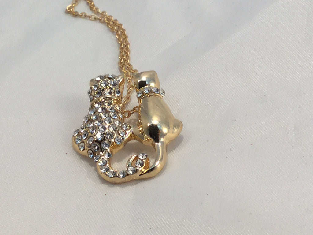 Gold cats necklace