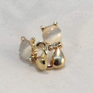 Gold and white cat earrings