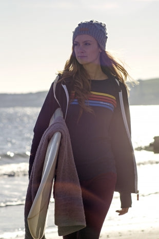 Brakeburn model female carrying a surf board