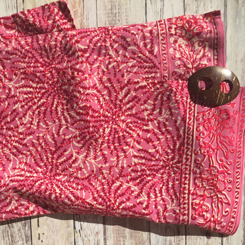 pink batik sarong with coconut shell buckle