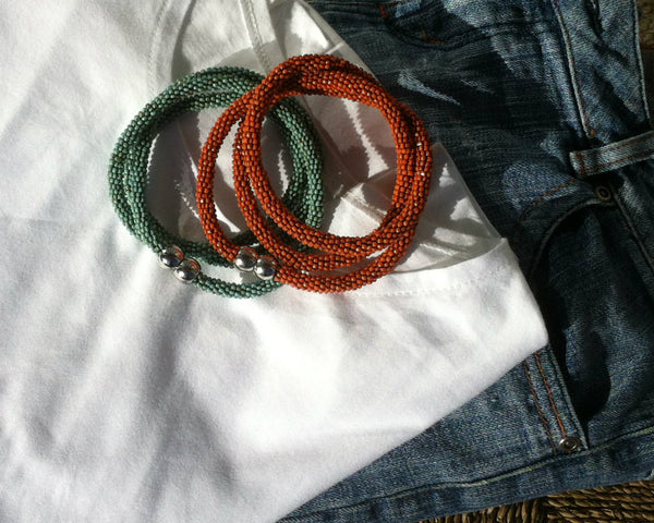 collection of blue and orange beaded bracelets