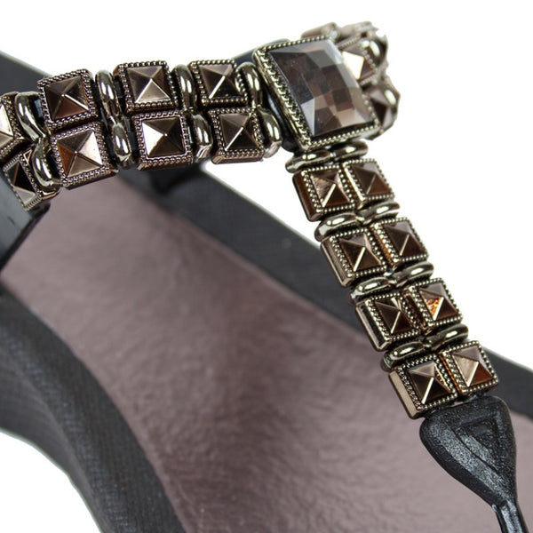Black wedge heel sandal close up