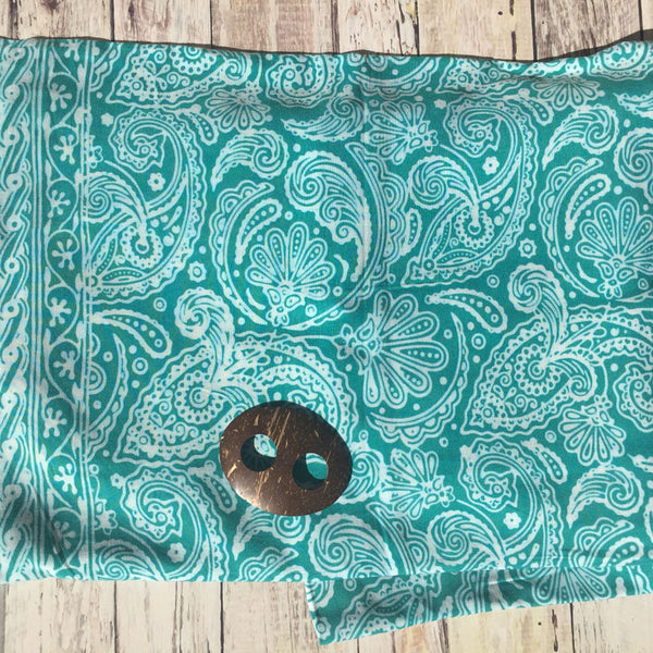 Green batik sarong with coconut shell buckle from Airy Mary