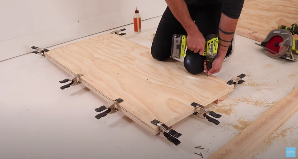 Ben Uyeda using a power drill/driver and clamps to build DIY furniture