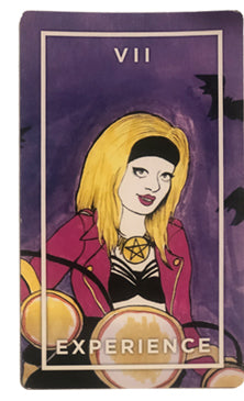 Experience Card from the Slutist Tarot Deck, shows blond woman with black headband and pink jacket riding a motorcycle