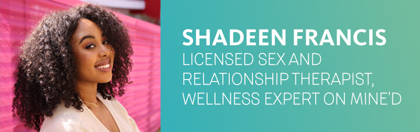 Image of Shadeen Francis, licensed wellness and relationships expert, leaning against a bright pink wall