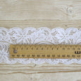Narrow French Stretch Lace Trim - White - buy online at The Fabric Store