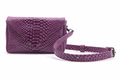 broad city purple clutch bag