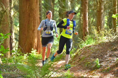 Emma McCosh overtaking in the forest