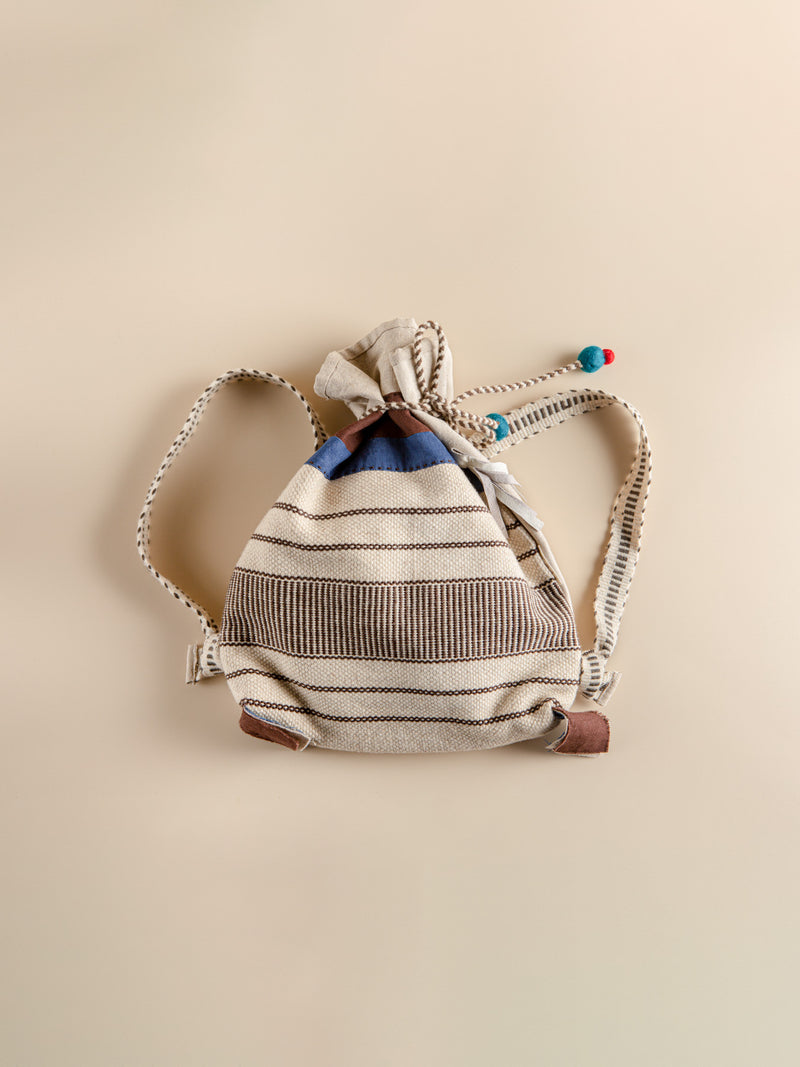 The backpack is handmade from natural fibers, an eco-friendly product.
