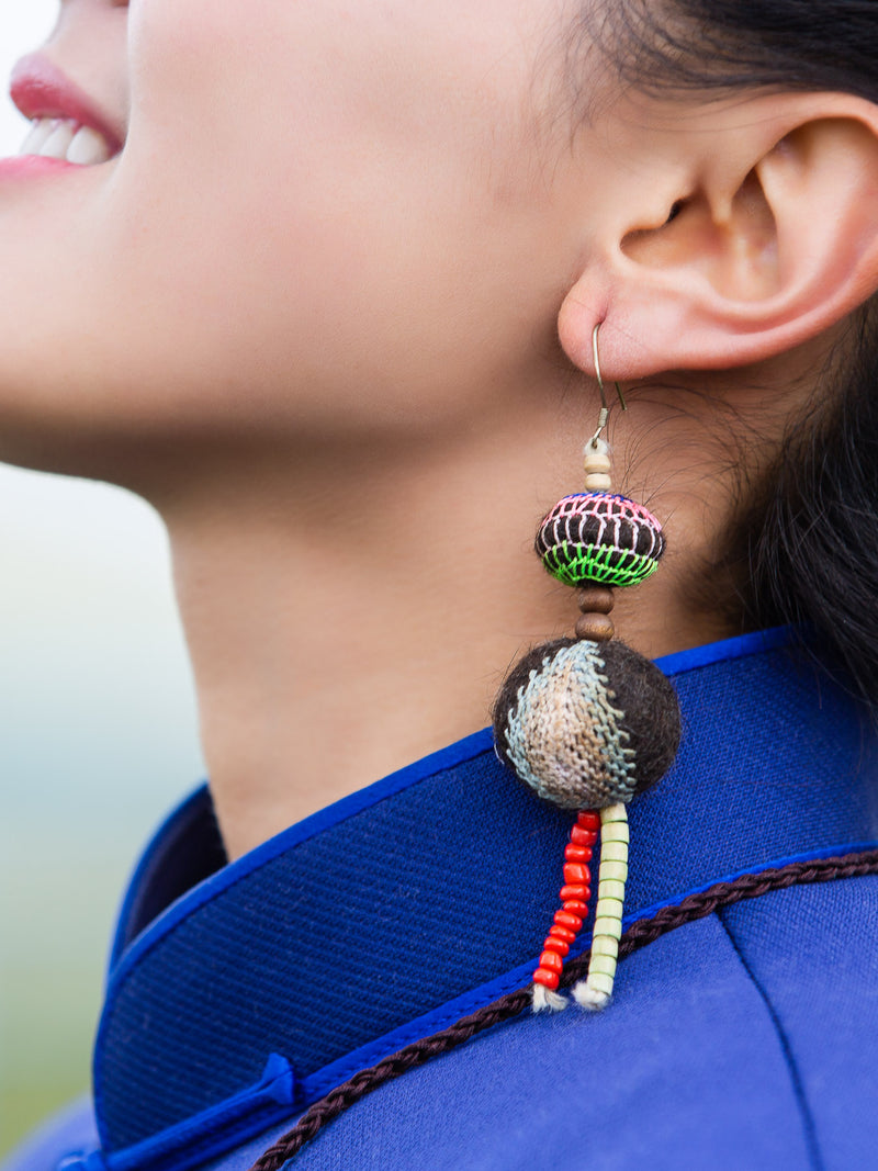 Traditional handmade earrings, ethnic characteristics, holiday gifts for friends.