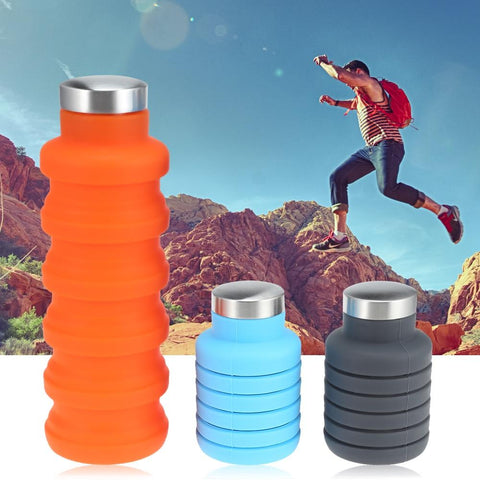 Collapsible water bottle with hiker traversing rocks in background