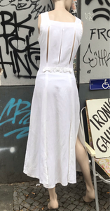 French white dress with slits and ribbons details