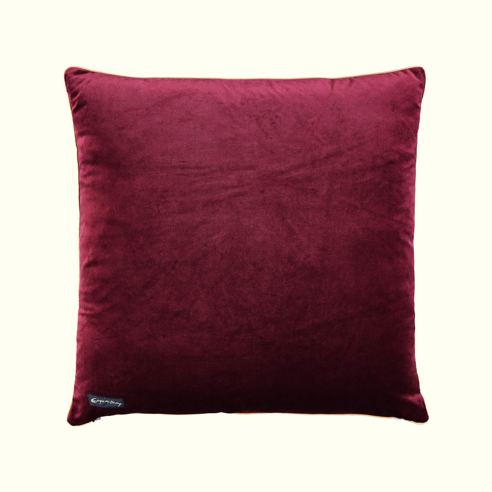 A luxury British silk velvet cushion by GVE in black and red Aurora print design.