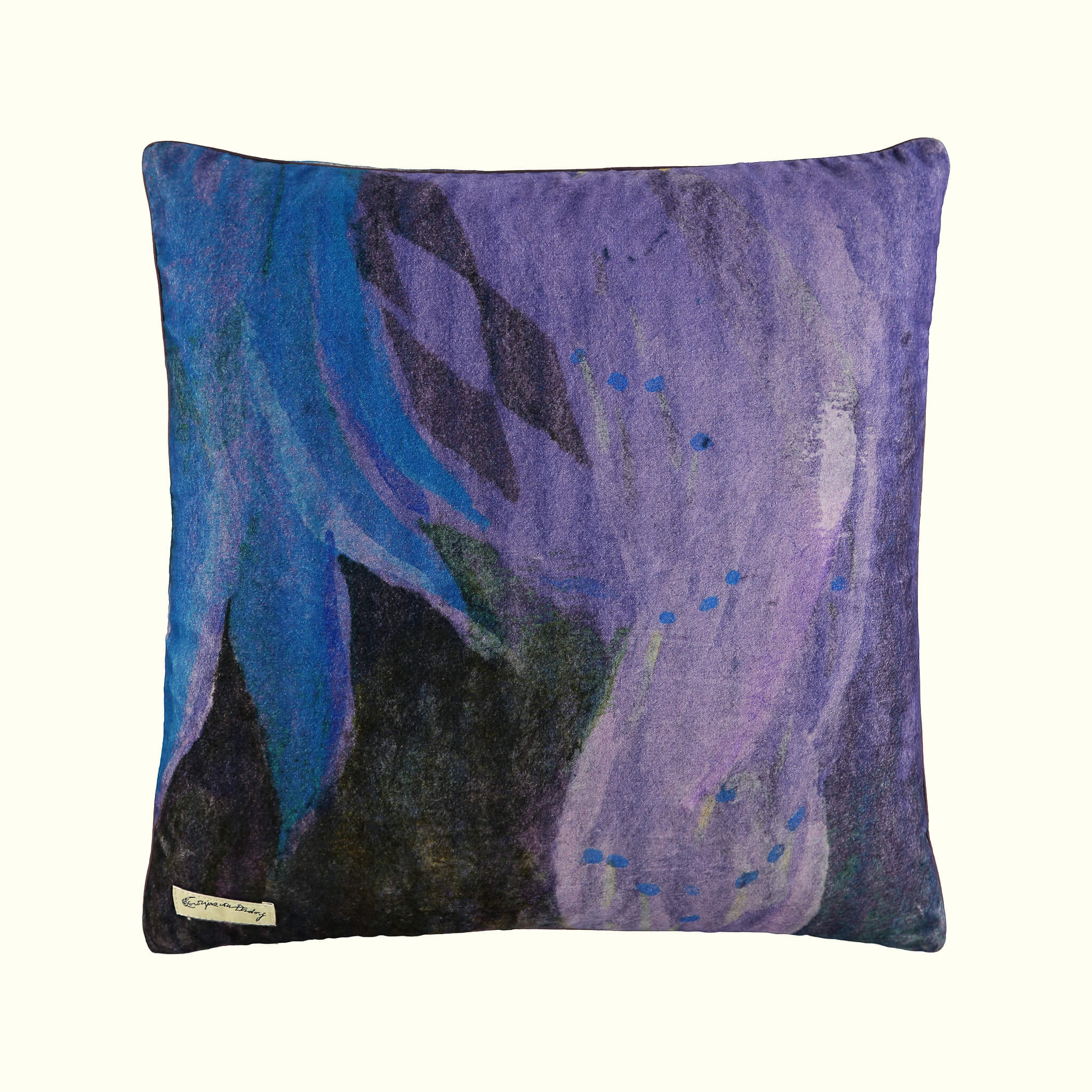 A luxury British cotton velvet cushion by GVE in violet Conversation print design.