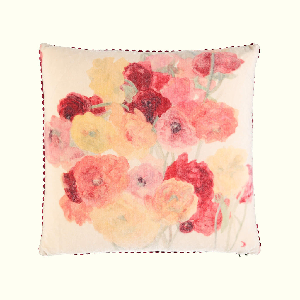 A luxury British silk velvet cushion by GVE in cream and scarlet Ranunculus print design.