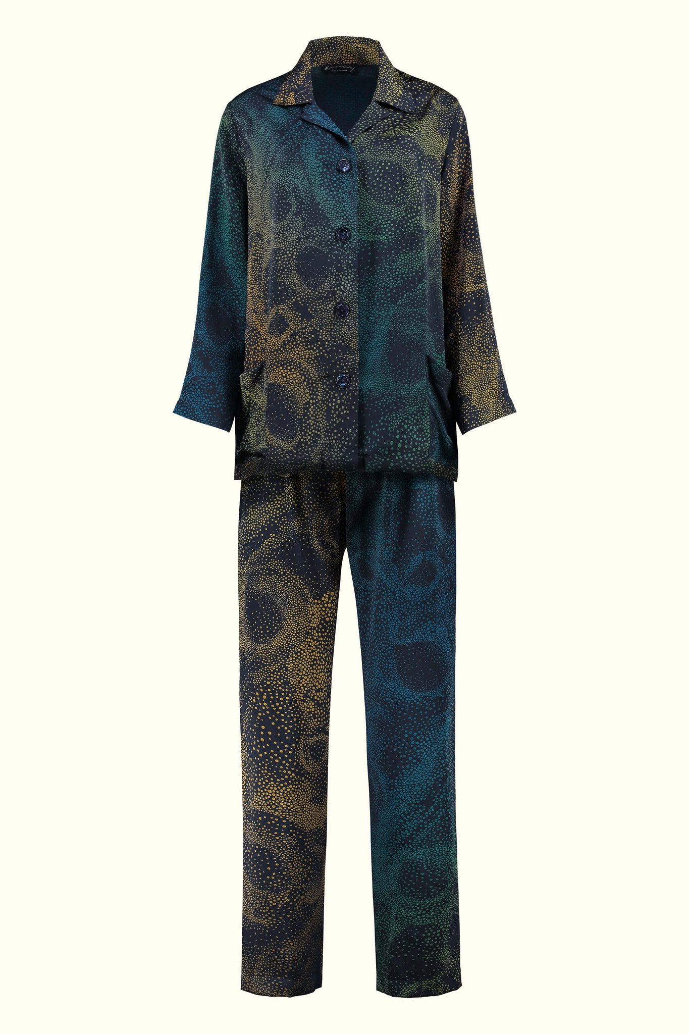 A luxury British silk pyjama set by GVE in navy and gold Aurora print design.
