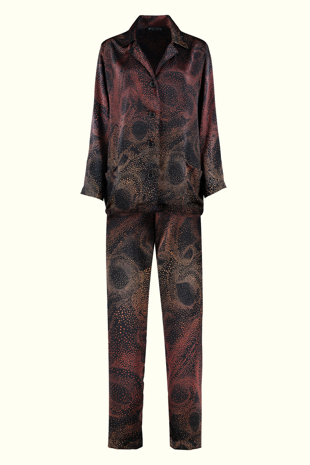 A luxury British silk pyjama set by GVE in black and red Aurora print design.