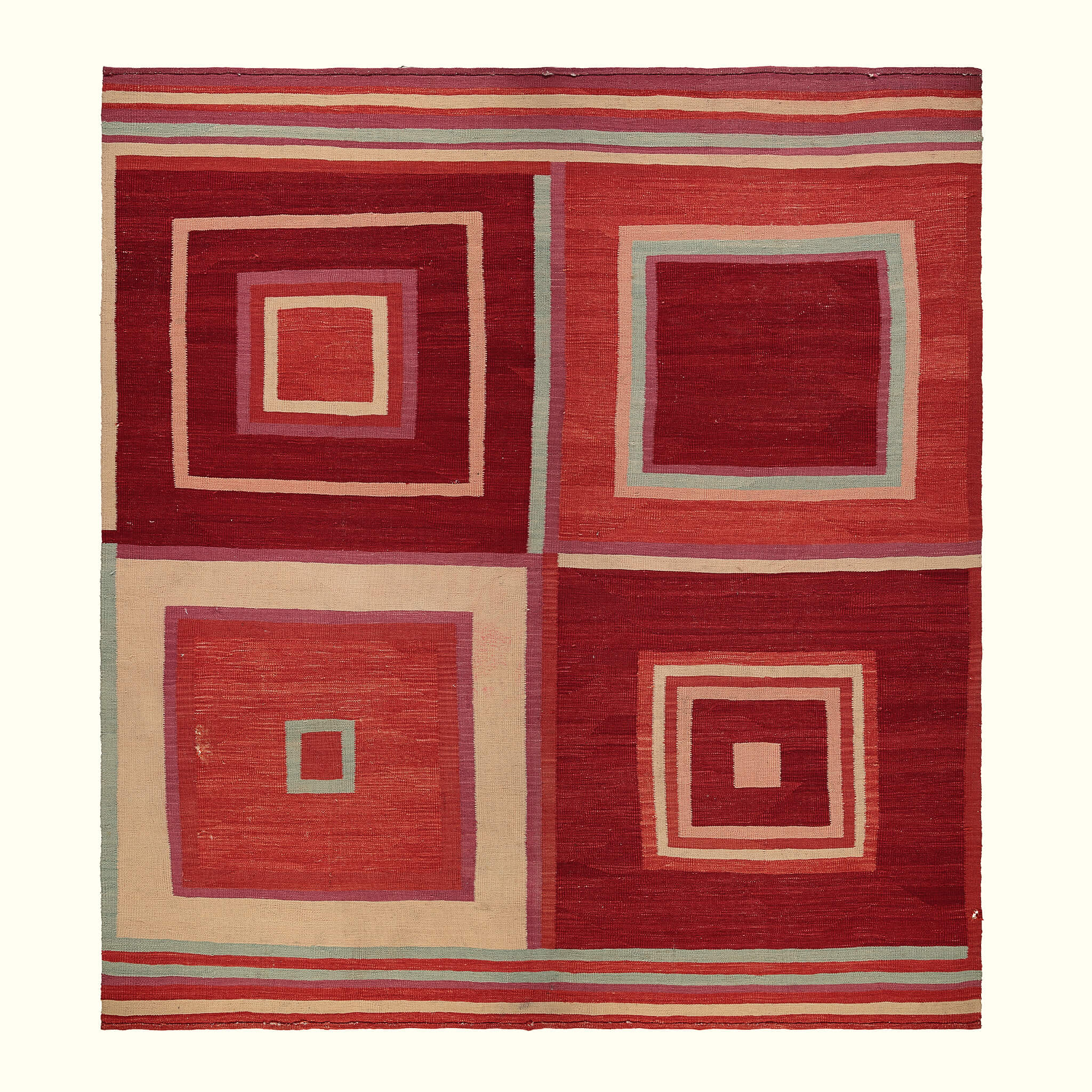 A luxury British handmade square rug by GVE in scarlet.