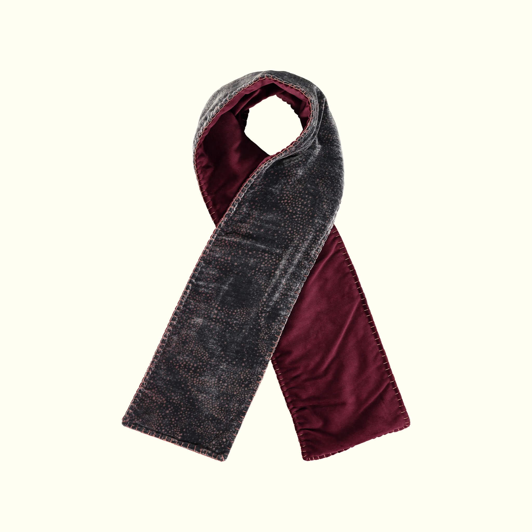 A luxury British silk velvet scarf by GVE in black and red Aurora print design.
