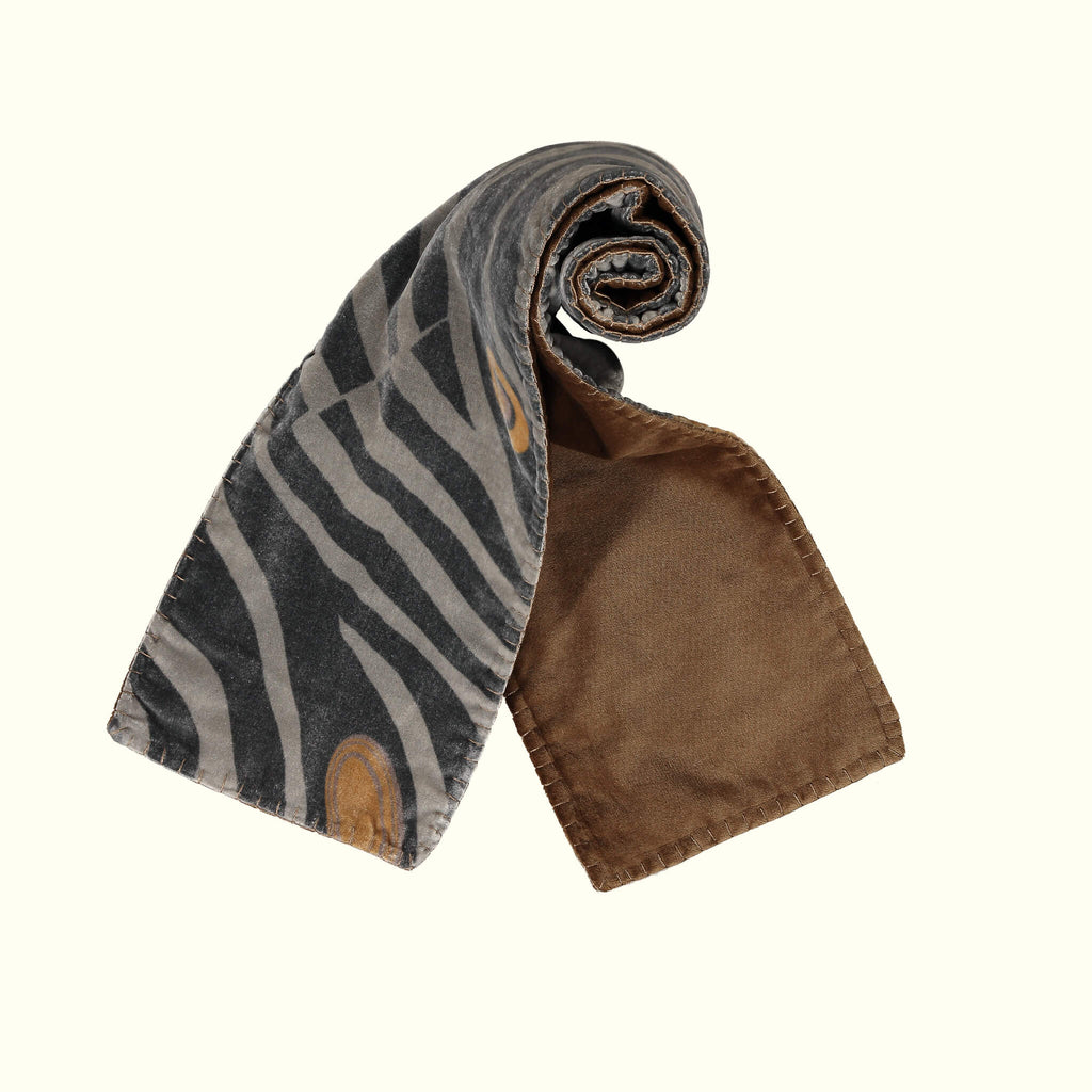 A luxury British silk velvet scarf by GVE in black Dune print design.